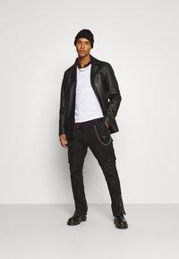 Tigha - ENRIQUE - Leather trousers - black - 1