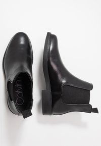 Calvin Klein - FINTAN CHELSEA - Classic ankle boots - black - 1
