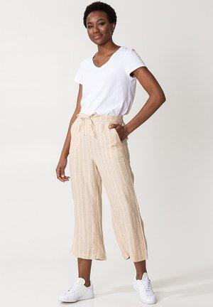 KAMAALA - Trousers - beige