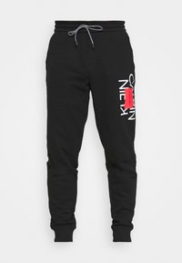Calvin Klein - TEXT REVERSED  - Tracksuit bottoms - black - 4