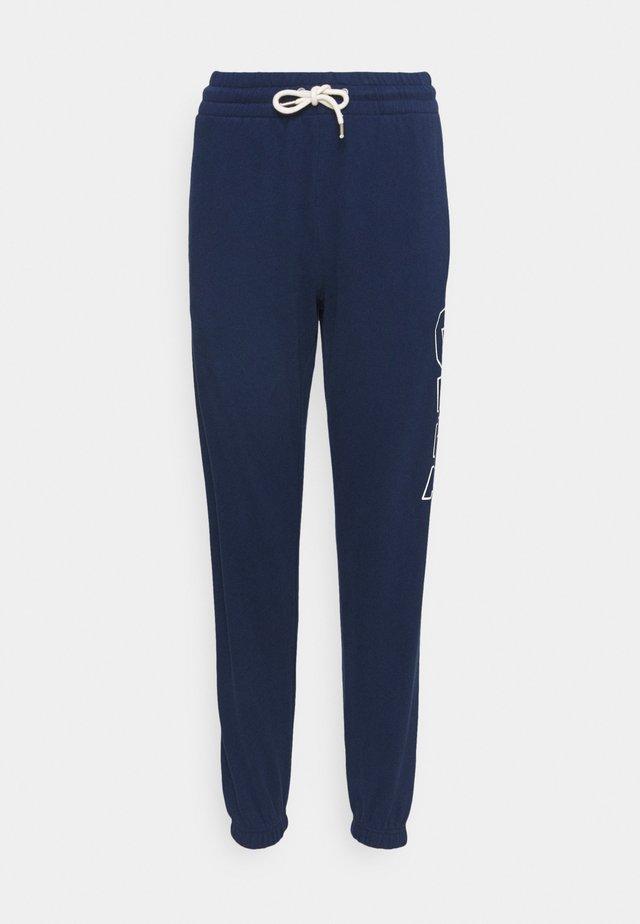 EASY - Spodnie treningowe - elysian blue