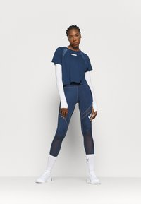 Puma - PAMELA REIF X PUMA COLLECTION  BOXY TEE - T-Shirt print - blue - 1