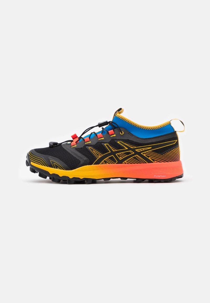 ASICS - FUJITRABUCO PRO - Trail running shoes - black/saffron