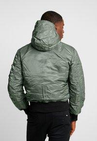 Alpha Industries - HOODED PUFFER - Light jacket - vintage green - 3