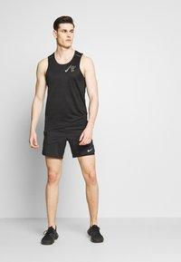 Nike Performance - DRY MILER TANK - Camiseta de deporte - black/reflective silver - 1