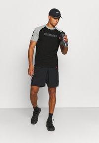 Hummel - T-shirts print - black - 1
