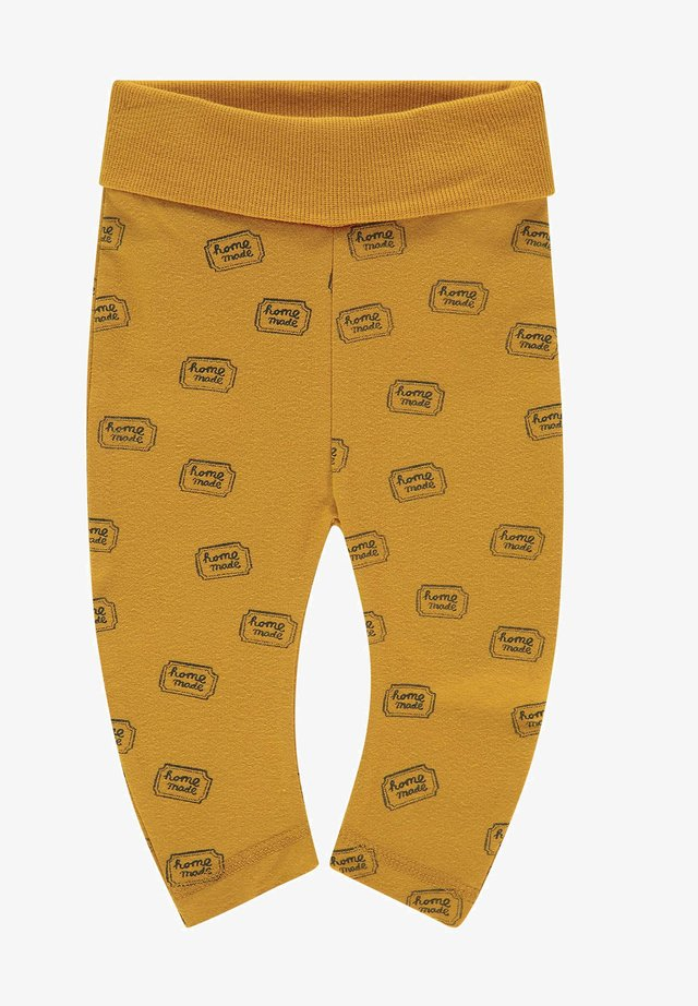 ANNAHILT - Leggings - Trousers - sunflower