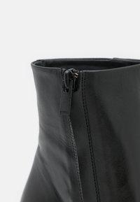 The Kooples - Kotníková obuv na vysokém podpatku - black - 6