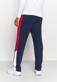 Fila - PALTI  PANTS - Teplákové kalhoty - black iris/true red/bright white - 2