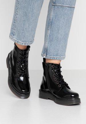 NERIA - Platform ankle boots - black