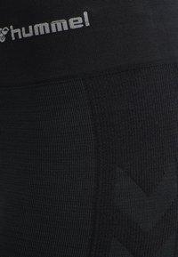 Hummel - HMLCLEA - Leggings - black melange - 8
