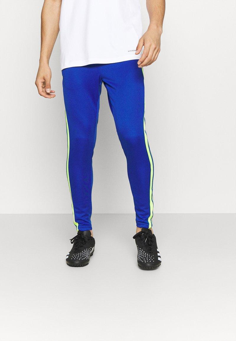 adidas Performance - SQUAD - Tracksuit bottoms - team royal blue/team solar yellow