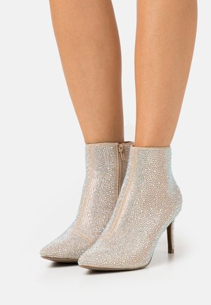 High heeled ankle boots - stone