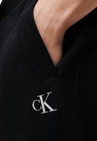 Calvin Klein Jeans - Tracksuit bottoms - ck black - 3