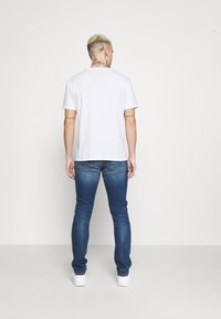 Tigha - MORTEN REPAIRED - Slim fit jeans - mid blue - 2