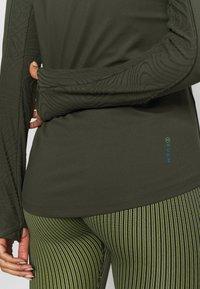Under Armour - RUSH - Sports shirt - baroque green - 5