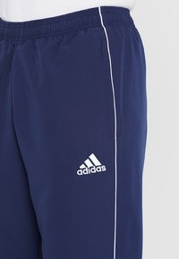 adidas Performance - CORE - Träningsbyxor - dark blue/white