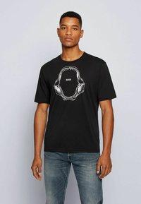 BOSS - TIMA - T-shirt med print - black - 0