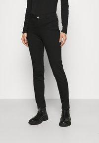NAF NAF - POWER SKINNY - Trousers - noir - 0