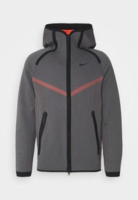 dark grey/turf orange/black