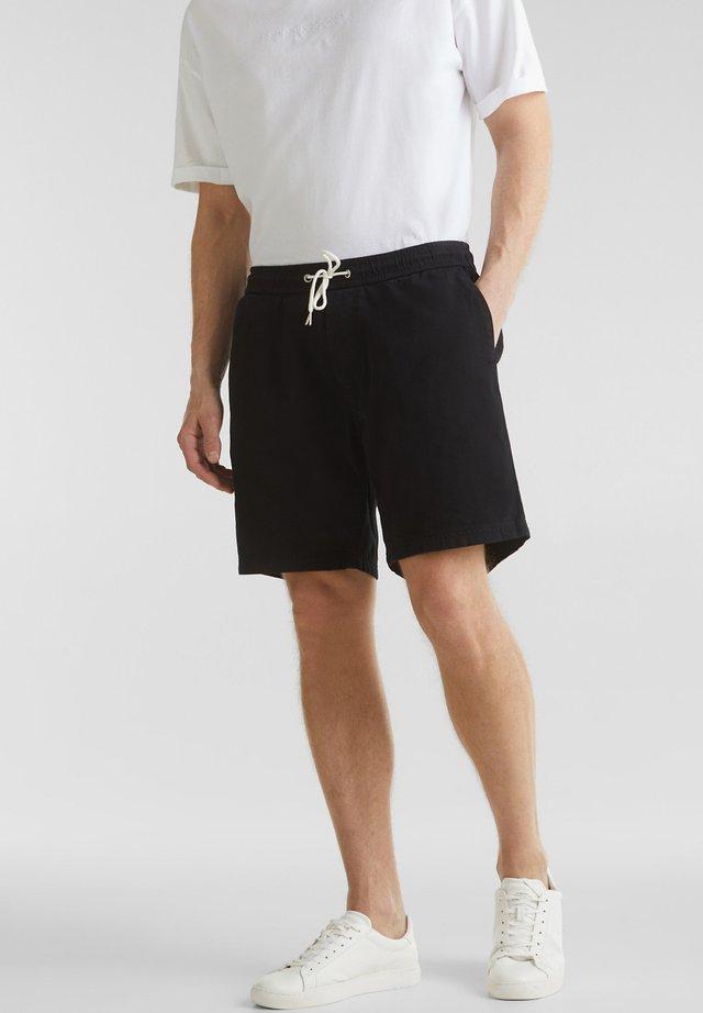 MIT GUMMIZUGBUND - Shorts - black