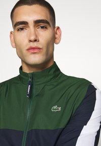 Lacoste Sport - TENNIS TRACKSUIT - Tracksuit - green/navy blue/white - 7