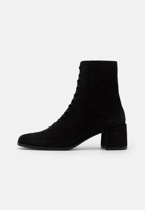 STINA - Lace-up ankle boots - black