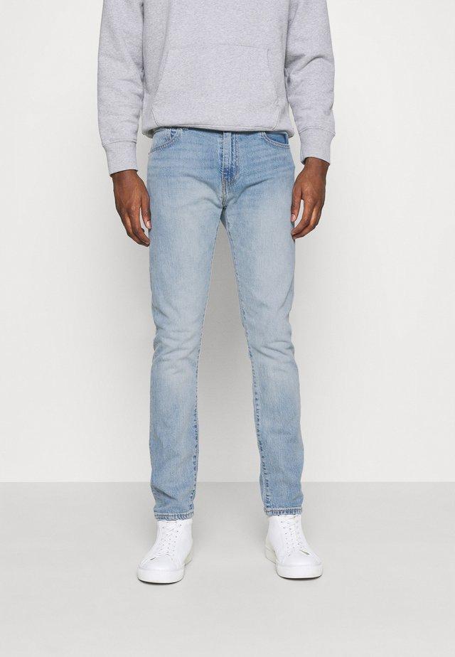 512™ SLIM TAPER - Jean slim - med indigo