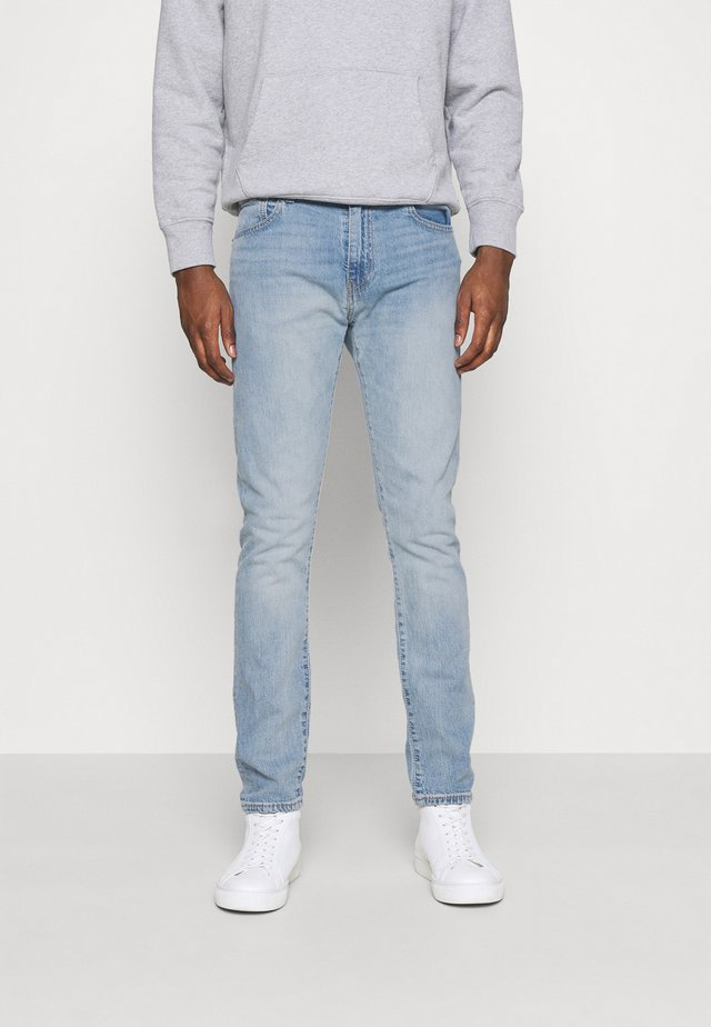 512™ SLIM TAPER - Slim fit jeans - med indigo