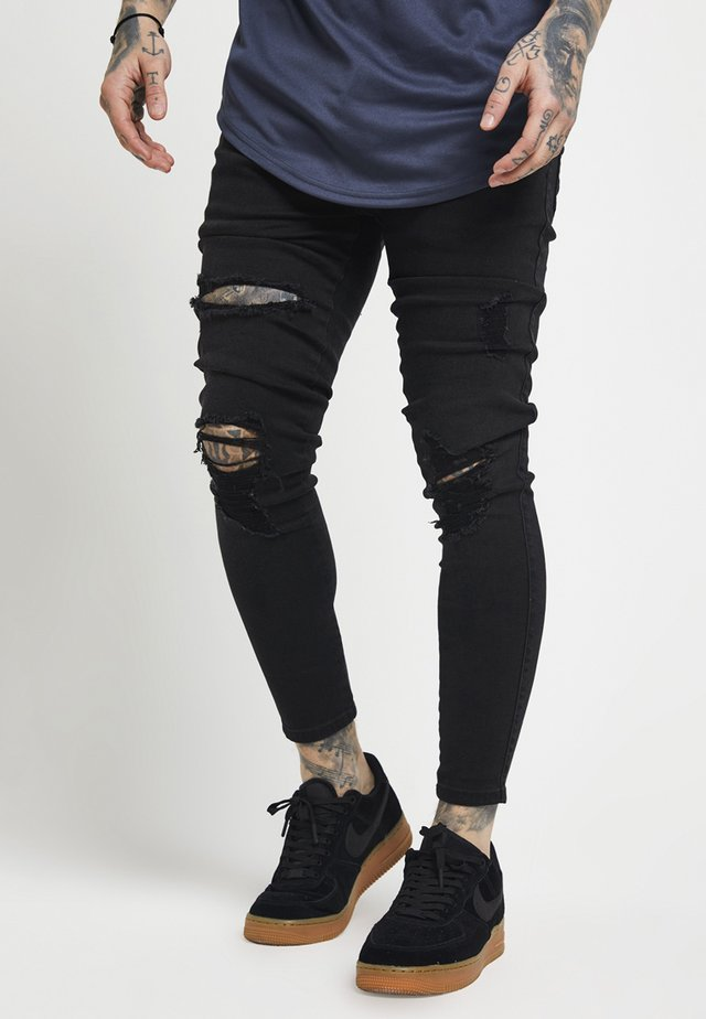 DISTRESSED SUPER - Skinny-Farkut - black