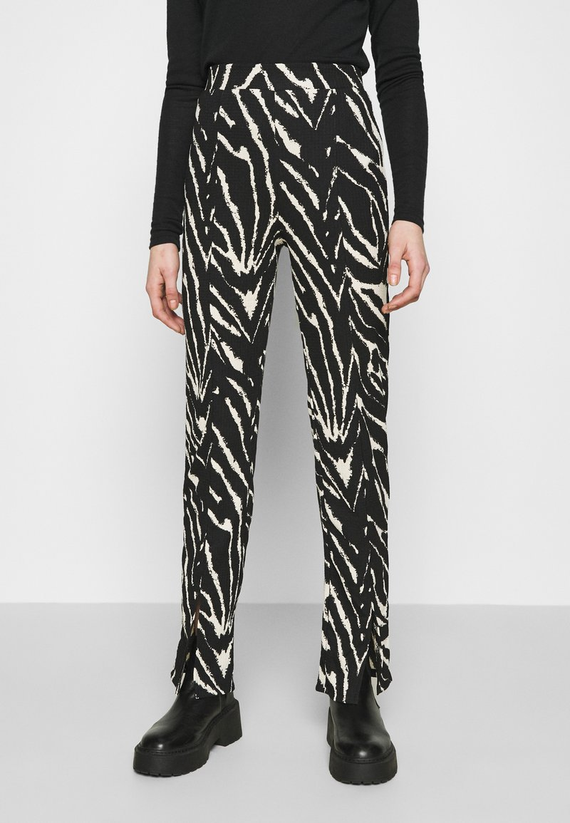 Monki - AIRY TROUSERS - Trousers - white/black