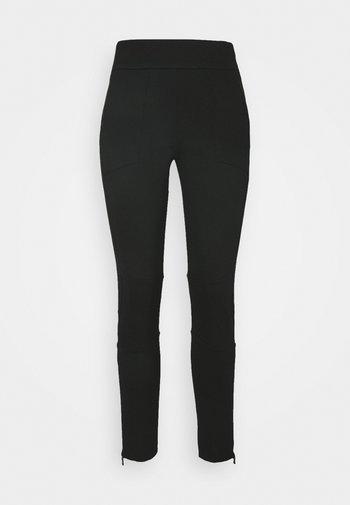 PANTZIP - Pantaloni sportivi - black
