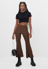 Bershka - Trousers - brown - 1