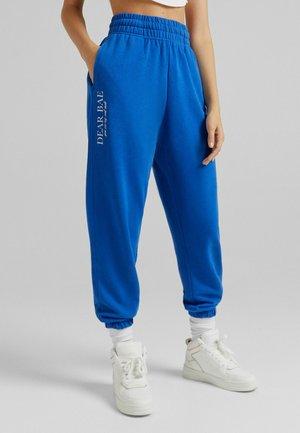 VARSITY-JOGGING - Tracksuit bottoms - blue
