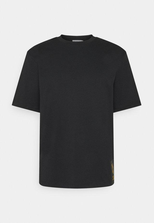 PRO - T-shirt con stampa - black