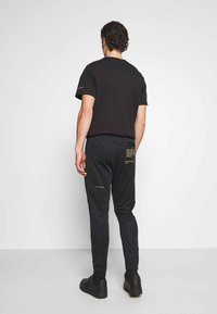 Nike Sportswear - PANT - Tracksuit bottoms - black/gold - 2
