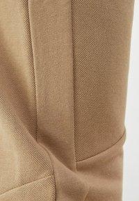 Bershka - Pantalon de survêtement - brown - 5