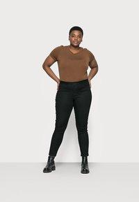 Vero Moda Curve - VMJUDY - Slim fit jeans - black - 1