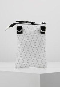 Indispensable - NECKPOUCH - Across body bag - white - 2
