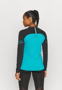 Dynafit - ALPINE PRO TEE - Sports shirt - black out ocean - 2