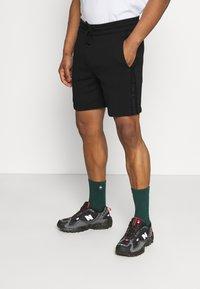 Calvin Klein Jeans - LOGO - Tracksuit bottoms - black - 0