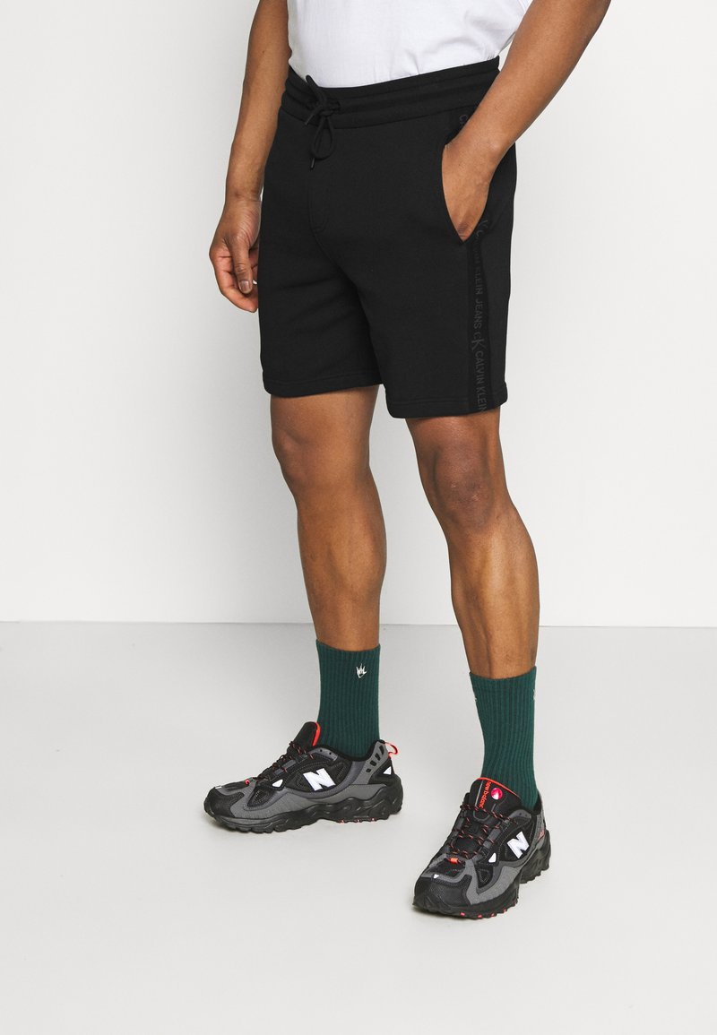 Calvin Klein Jeans - LOGO - Tracksuit bottoms - black