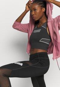 Puma - EVOSTRIPE EVOKNIT CROP - Sports shirt - black - 3
