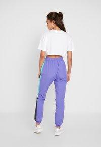 Ellesse - EULALIA - Tracksuit bottoms - purple - 2