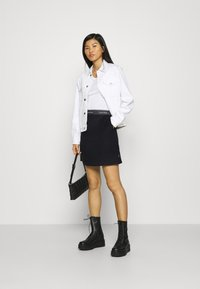 Calvin Klein - DOUBLE FACE SKIRT - Mini skirt - black - 1
