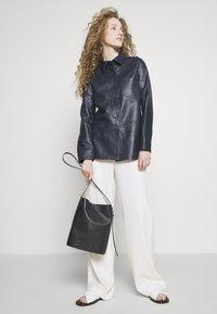 PB 0110 - Handbag - black - 1