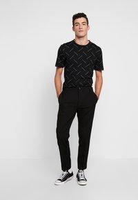 Calvin Klein Tailored - PINSTRIPE TROUSER CASUAL - Trousers - black - 1