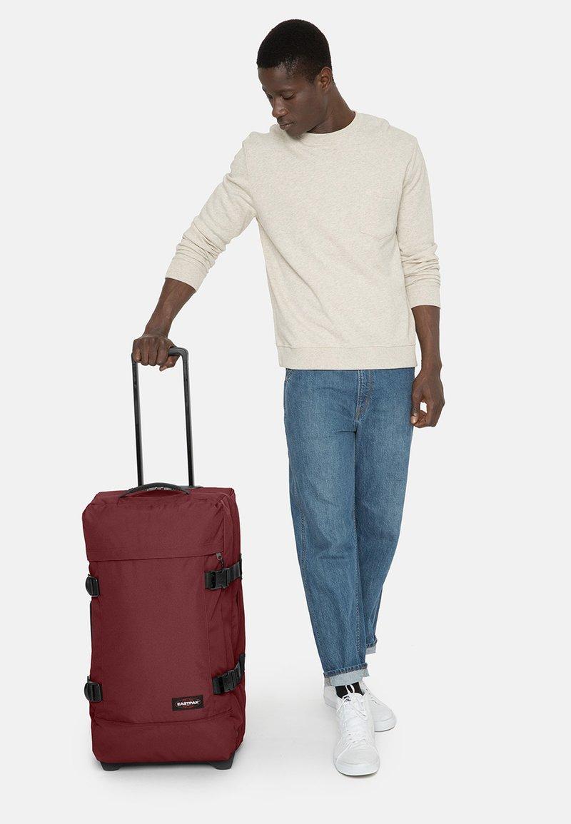 Eastpak - TRANVERZ M - Wheeled suitcase - brisk burgundy