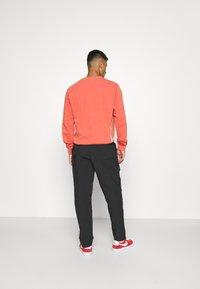 Nike Sportswear - Trousers - black - 2