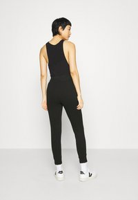CALANDO - Tracksuit bottoms - black - 2